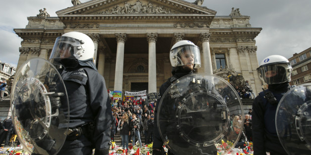"Police in riot gear protect one of the memorials to the victims of the recent Brussels attacks, a right wing demonstrators  protest near the Place de la Bourse in Brussels, Sunday, March, 27, 2016.  In a sign of the tensions in the Belgian capital and the way security services are stretched across the country, Belgium's interior minister appealed to residents not to march Sunday in Brussels in solidarity with the victims.""We understand fully the emotions,"" Interior Minister Jan Jambon told repor"