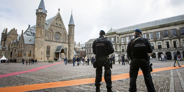 Dutch military police stand guard at the Binnenhof during a patrol in The Hague on March 23, 2016 as security measures were reinforced in the wake of attacks in Brussels.