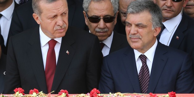 Turkey's President Recep Tayyip Erdogan (L) and Turkey's former President Abdullah Gul (R) attend the state funeral of Turkey's ninth President and former Prime Minister, Suleyman Demirel, at the Grand National Assembly of Turkey (TBMM) in Ankara, Turkey on June 19, 2015..  Turkey's former president and prime minister Suleyman Demirel, a giant figure in the country's politics for over half a century, died on June 17, 2015. In a remarkable career, Demirel survived his dismissal in two military coups and a ban on holding office to become president and one of Turkey's most respected elder statesmen. AFP PHOTO / ADEM ALTAN        (Photo credit should read ADEM ALTAN/AFP/Getty Images)