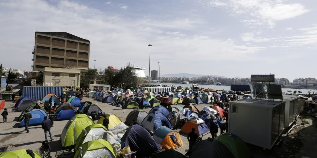Tents are seen at the Athens' port of Piraeus, where over 5,000 refugees and migrants stay, on Tuesday, March 22, 2016. Greece detained hundreds of refugees and migrants on its islands Monday, as officials in Athens and the European Union conceded a much-heralded agreement to send thousands of asylum-seekers back to Turkey is facing delays. (AP Photo/Thanassis Stavrakis)