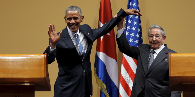 U.S. President Barack Obama and Cuban President Raul Castro gesture after a news conference as part of Obama's three-day visit to Cuba, in Havana March 21, 2016. REUTERS/Carlos Barria   TPX IMAGES OF THE DAY