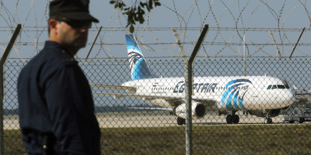 A policeman stands guard at Larnaca Airport near a hijacked Egyptair A320 , March 29, 2016.      REUTERS/Yiannis Kourtoglou