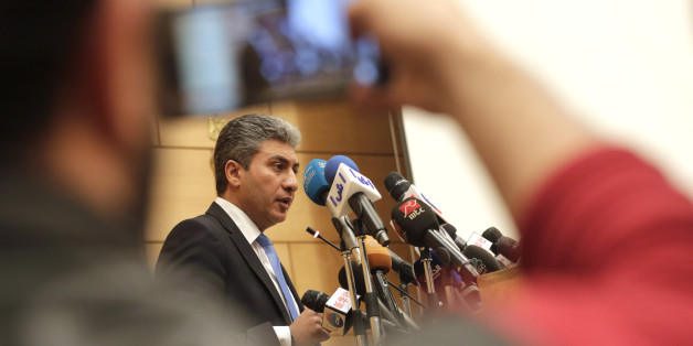 Egyptian Minister of Civil Aviation Sharif Fathy speaks during a press conference at the Ministry headquarters in Cairo, Egypt, Tuesday, March 29, 2016. Fathy said seven people remain with the hijacker on the EgyptAir plane that has landed in Cyprus, four crew and three passengers. (AP Photo/Amr Nabil)
