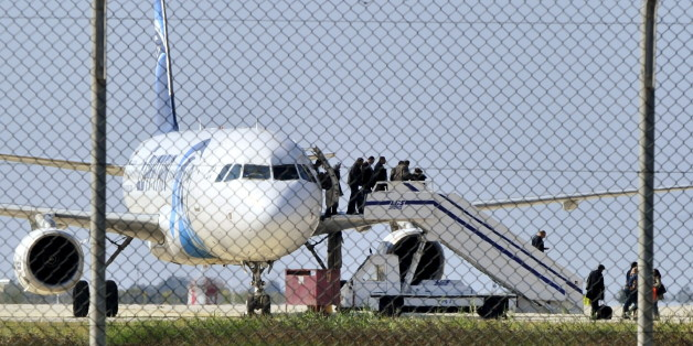 Passengers evacuate a hijacked EgyptAir Airbus 320 plane at Larnaca airport, Cyprus, March 29, 2016. REUTERS/Stringer        EDITORIAL USE ONLY. NO RESALES. NO ARCHIVE