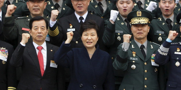 GYERYONG, SOUTH KOREA - MARCH 04:  South Korean President Park Geun-Hye cheers with new military officers during a military commissioning ceremony at Gyeryongdae, South Korea's main military compound on March 4, 2016 in Gyeryong, South Korea. Total 6003 graduates from the country's six major military academies were commissioned at the ceremony. REUTERS/Chung Sung-Jun/Pool