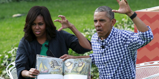"""U.S. President Barack Obama and first lady Michelle Obama perform a reading of the children's book """"Where the Wild Things Are"""" for children gathered for the annual White House Easter Egg Roll on the South Lawn of the White House in Washington, March 28, 2016. REUTERS/Yuri Gripas      TPX IMAGES OF THE DAY"""
