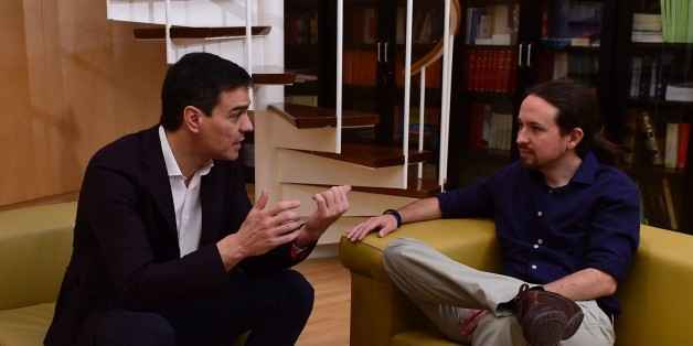 Leader of the Spanish Socialist Party (PSOE) Pedro Sanchez (L) speaks with leader of the left wing party Podemos, Pablo Iglesias during their meeting at Las Cortes (Spanish parliament) in Madrid on March 30, 2016. / AFP / PIERRE-PHILIPPE MARCOU        (Photo credit should read PIERRE-PHILIPPE MARCOU/AFP/Getty Images)