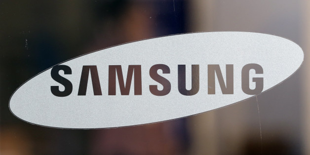 A logo of Samsung Electronics Co. is seen at its shop in Seoul, South Korea, Thursday, Oct. 29, 2015. Samsung Electronics Co. reported its first earnings gain in more than a year on Thursday as a record profit from computer chips masked a decline in its smartphone business. (AP Photo/Lee Jin-man)