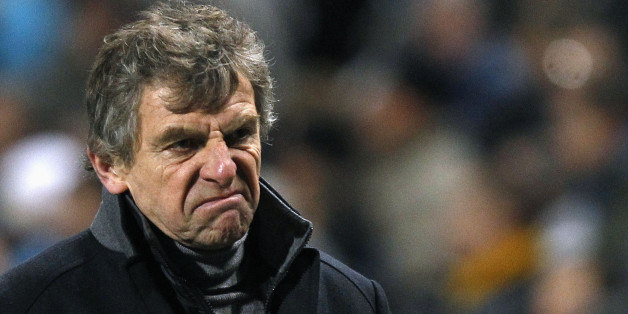 Lorient's head coach Christian Gourcuff reacts on the pitch at half-time during his French Ligue 1 soccer match against Olympique Marseille at the Velodrome stadium in Marseille, December 17, 2011. REUTERS/Jean-Paul Pelissier (FRANCE - Tags: SPORT SOCCER)