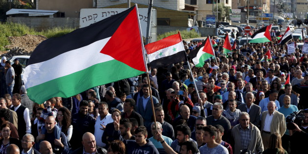 Israeli Arab demonstrators take part in a Land Day rally in the northern Israeli village of Arrabe March 30, 2016. Land Day commemorates the killing of six Arab citizens of Israel by security forces during protests in 1976 over government land confiscations. REUTERS/Ammar Awad