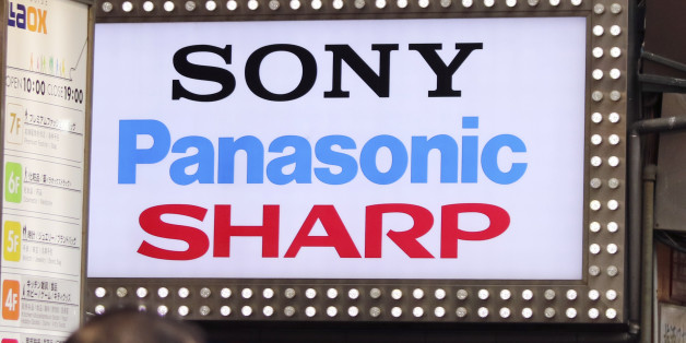 The brands' names of Japanese electronics makers, including Sharp, are displayed on a signboard of a retailer at Akihibara shopping district in Tokyo, Saturday, April 2, 2016. The head of Foxconn says the Taiwanese contract manufacturer will turn around struggling Japanese electronics maker Sharp. The leaders of the two companies met Saturday in Japan to sign agreements for Foxconn to buy a 66 percent share in the 104-year-old Japanese firm.  (AP Photo/Shuji Kajiyama)