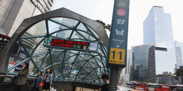 """People come out at Gangnam subway station in the Gangnam area of Seoul October 2, 2012. Gangnam is the most upmarket neighbourhood in the South Korean capital. Known as Seoul's """"Beverly Hills"""", its streets are lined with designer-brand shops and trendy bars and restaurants. Chubby South Korean singer Psy was raised in the area and his hit song """"Gangnam Style"""", with his quirky horse-riding dance, has stormed to number one in charts around the world while the video has been watched more than 454 m"""