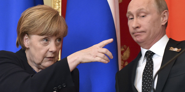German Chancellor Angela Merkel (L) gestures as Russian President Vladimir Putin looks on during a news conference after talks at the Kremlin in Moscow, Russia, May 10, 2015. Russian President Vladimir Putin said on Sunday that a peace deal agreed in Minsk over the separatist conflict in east Ukraine was moving forward despite problems and that it had been quieter in Ukraine recently. Putin made the comments at a news conference in Moscow with Germany's Angela Merkel. REUTERS/Kirill Kudryavtsev/