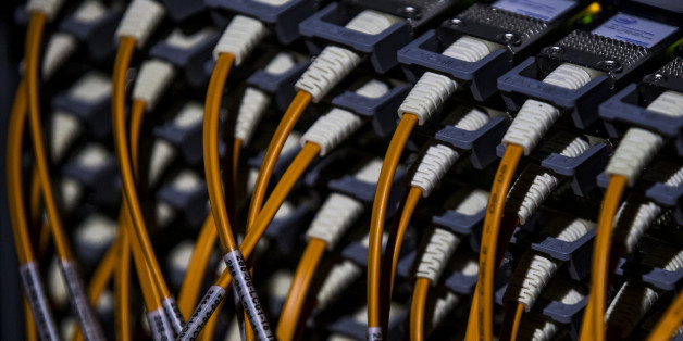 A picture shows wires at the back of a super computer at the Konrad-Zuse Centre for applied mathematics and computer science, in Berlin August 13, 2013.  REUTERS/Thomas Peter (GERMANY - Tags: SCIENCE TECHNOLOGY)