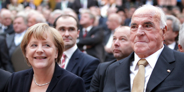 Former German Chancellor Helmut Kohl (R) and German Chancellor Angela Merkel sit in the first row at the German Historical Museum (Deutsches Historisches Museum) in Berlin on September 27, 2012. Kohl, who is celebrating the 30th anniversary of being elected Chancellor, was invited by the Konrad-Adenauer-Stiftung in honor of his political achievements. Kohl was elected German Chancellor for the first time on October 1, 1982 and led the country for 16 years.  AFP PHOTO / POOL / WOLFGANG KUMM        (Photo credit should read WOLFGANG KUMM/AFP/GettyImages)