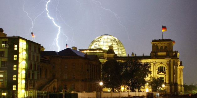 A bolt of lightning is seen during a thunderstorm over the Reichstagbuilding in Berlin late August 28, 2002. The Reichstags building is theseat of the German lower house of parliament Bundestag. REUTERS/ArndWiegmannAKW/CLH/