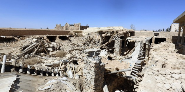 A general view shows damages at Mar Elian monastery in Qaryatain, near the central city of Homs, Syria on Monday, April 4, 2016. Qaryatain used to be home to a sizable Christian population and lies midway between Palmyra and the capital, Damascus. Activists said last summer that Qaryatain had a mixed population of around 40,000 Sunni Muslims and Christians, as well as thousands of internally displaced people who had fled from the nearby city of Homs. Many of the Christians fled the town after it