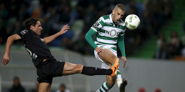 Football Soccer - Sporting v Academica - Portuguese Premier League - Alvalade, Lisbon, Portugal - 30/01/16 Sporting's Islam Slimani (R) and Academica's Fernando Alexandre in action.  REUTERS/Rafael Marchante