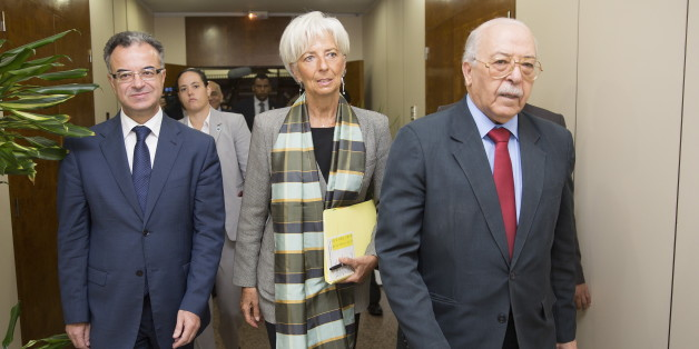 International Monetary Fund (IMF) Managing Director Christine Lagarde (C) meets with Tunisia's Central Bank Governor Chadli Ayari (R) and Tunisia's Finance Minister Slim Chaker (L) at the Central Bank of Tunisia in Tunis, Tunisia September 8, 2015. REUTERS/Stephen Jaffe/IMF Staff/Handout via Reuters ATTENTION EDITORS - THIS PICTURE WAS PROVIDED BY A THIRD PARTY. REUTERS IS UNABLE TO INDEPENDENTLY VERIFY THE AUTHENTICITY, CONTENT, LOCATION OR DATE OF THIS IMAGE. FOR EDITORIAL USE ONLY. NOT FOR SA
