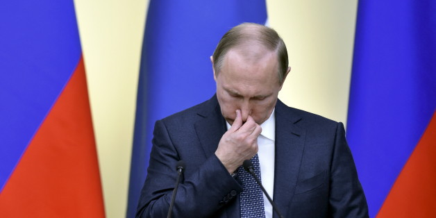 Russian President Vladimir Putin wipes his nose during a joint news conference with his Finnish counterpart Sauli Niinisto following their talks at the Novo-Ogaryovo state residence outside Moscow, Russia, March 22, 2016.  REUTERS/Kirill Kudryavtsev/Pool