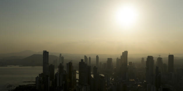 """Panama City skyline is silhouette at sunset in Panama, Monday, April 4, 2016. Panama's president says his government will cooperate """"vigorously"""" with any judicial investigation arising from the leak of a vast trove of information on the offshore financial dealings of the world's rich and famous. An international coalition of media outlets Sunday published investigations it said stemmed from the leak of 115 million records kept by the Panama-based law firm Mossack Fonseca on behalf of clients. (AP Photo/Arnulfo Franco)"""