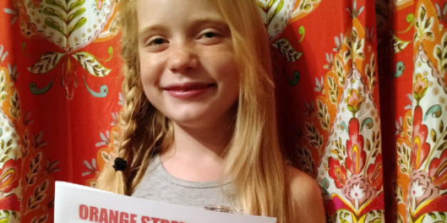 In this September 2015, photo provided by Matthew Lysiak, Hilde Kate Lysiak poses for a photo at her home in Selinsgrove, Pa. Lysiak, a 9-year-old reporter, recently wrote about a suspected murder in her small Pennsylvania town and is defending herself after some locals lashed out about a young girl covering violent crime. (Isabel Rose Lysiak via AP)