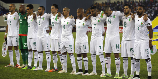 Algeria's national soccer team players listen to their national anthem before their quarter-final soccer match of the 2015 African Cup of Nations against Ivory Coast in Malabo February 1, 2015. REUTERS/Amr Abdallah Dalsh (EQUATORIAL GUINEA - Tags: SPORT SOCCER)