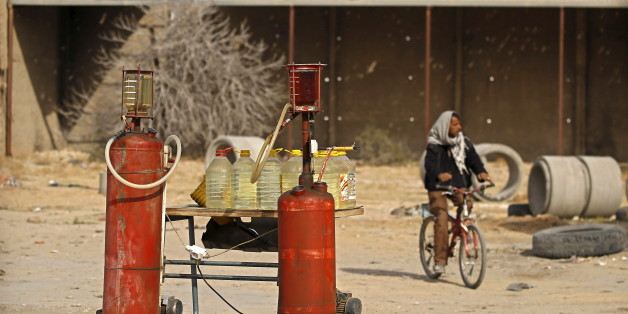 "A man rides a bicycle as he passes tanks of gasoline in Kasserine, Tunisia January 30, 2016. A litre of fuel is priced at 1.5 Tunisian dinars ($0.74). A dramatic drop in oil prices, driven down by a glut in supply, is translating into a mixed bag for motorists. All countries have access to the same oil prices on international markets, but retail prices vary wildly, largely because of taxes and subsidies. REUTERS/Zohra Bensemra   SEARCH ""THE WIDER IMAGE"" FOR ALL STORIES      TPX IMAGES OF THE DAY"