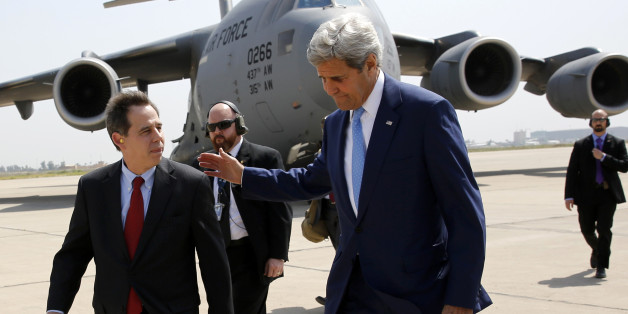 US ambassador to Iraq Stuart Jones (L) walks with Secretary of State John Kerry (R) as he arrives via military transport at Baghdad International Airport in Baghdad on April 8, 2016. / AFP / POOL / JONATHAN ERNST        (Photo credit should read JONATHAN ERNST/AFP/Getty Images)