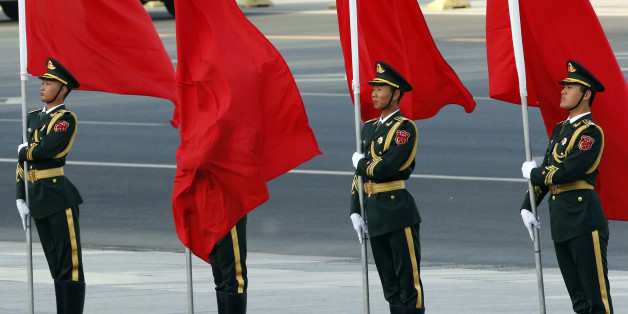A red flag covers a soldier from Chinese honour guards during a welcoming ceremony for Swiss President Johann Schneider-Ammann at the Great Hall of the People in Beijing, China, April 8, 2016. REUTERS/Kim Kyung-Hoon