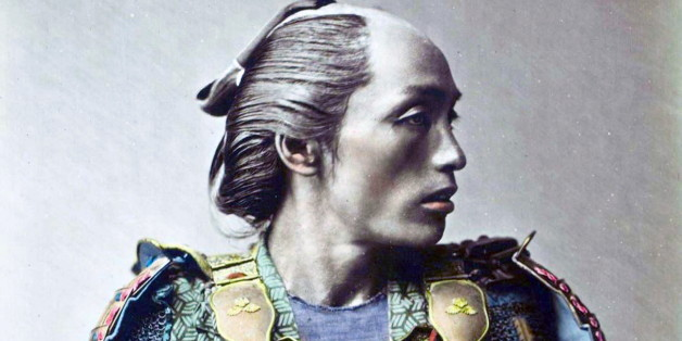Hand-Colour photograph of a Japanese Samurai warrior by Franz von Stillfried-Ratenicz. Dated 1881. (Photo by: Universal History Archive/UIG via Getty Images)
