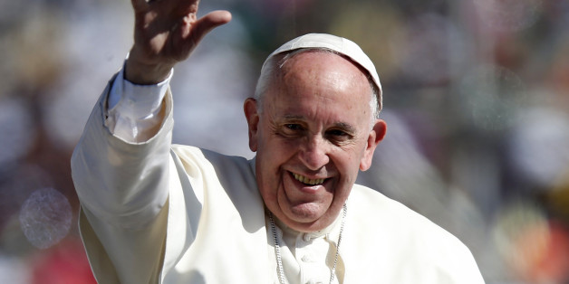 Pope Francis waves to the crowd while arriving to celebrate Mass in San Cristobal de las Casas, February 15, 2016. REUTERS/Edgard Garrido