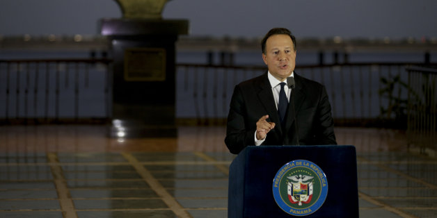 "With a bust of Latin America's independence hero Simon Bolivar in the background, Panama's President Juan Carlos Varela gives a televised statement to the nation, in Panama City, Wednesday, April 6, 2016. Varela spoke about the millions of confidential documents that were leaked from a Panama-based law firm, coined the ""panama papers,"" revealing details of how some of the globe's richest people funnel their assets into secretive shell companies set up in Panama and in other lightly regulated jur"