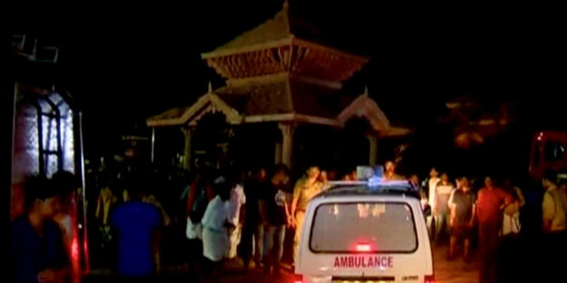 An ambulance is seen next to people after a fire broke out as people gathered for a fireworks display at a temple in Kollam, southern India, in this still image taken from video April 10, 2016. REUTERS/ANI via REUTERS TV  ATTENTION EDITORS - THIS PICTURE WAS PROVIDED BY A THIRD PARTY. REUTERS IS UNABLE TO INDEPENDENTLY VERIFY THE AUTHENTICITY, CONTENT, LOCATION OR DATE OF THIS IMAGE. EDITORIAL USE ONLY. NOT FOR SALE FOR MARKETING OR ADVERTISING CAMPAIGNS. NO RESALES. NO ARCHIVE. THIS PICTURE IS DISTRIBUTED EXACTLY AS RECEIVED BY REUTERS, AS A SERVICE TO CLIENTS. NO ACCESS BBC. FOR REUTERS CUSTOMERS ONLY.
