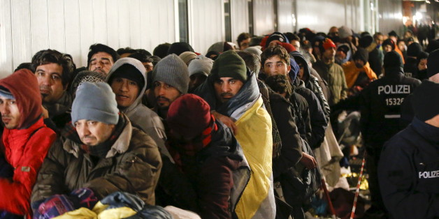 Migrants queue on a street to enter the compound outside the Berlin Office of Health and Social Affairs (LAGESO) for their registration process in Berlin, Germany, December 9, 2015. REUTERS/Fabrizio Bensch