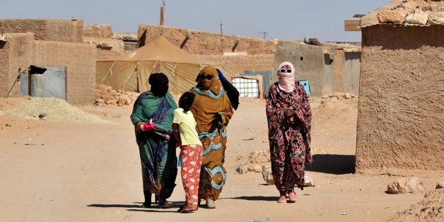 Sahrawi womenwalk through the Smara refugee camp near Tindouf, south-western Algeria, Friday, March 4, 2016. U.N. chief Ban Ki-moon is expected to arrive in Tindouf on March 5 to visit Sahrawi refugee camps.  Ban Ki-moon will meet with leaders of the Polisario Front, the organization disputing sovereignty over Western Sahara with Morocco, in the hope to help solving a 40-year conflict. (AP Photo/Toukik Doudou).