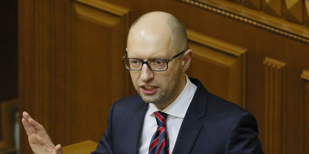 Ukrainian Prime Minister Arseniy Yatsenyuk speaks during an annual report in Parliament in Kiev, Ukraine, Tuesday, Feb. 16, 2016. Ukraine's Prime Minister faces a possible no-confidence vote during a parliamentary session, which could remove him from office. (AP Photo/Sergei Chuzavkov)
