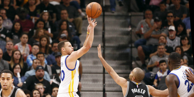 Apr 10, 2016; San Antonio, TX, USA; Golden State Warriors point guard Stephen Curry (30) shoots the ball over San Antonio Spurs point guard Tony Parker (9) during the first half at AT&T Center. Mandatory Credit: Soobum Im-USA TODAY Sports