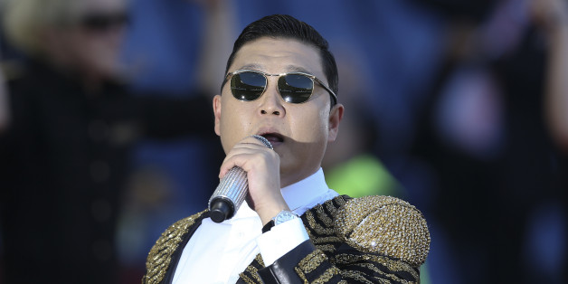 South Korean singer Psy performs before the Italian Cup final soccer match between AS Roma and SS Lazio at the Olympic Stadium in Rome May 26, 2013.  REUTERS/Alessandro Bianchi (ITALY - Tags: SPORT SOCCER ENTERTAINMENT)