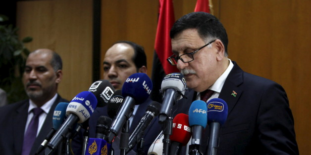Libyan prime minister-designate under a proposed National Unity government Fayez Seraj (R) attends a news conference in Tripoli, Libya, March 30, 2016. REUTERS/Ismail Zitouny