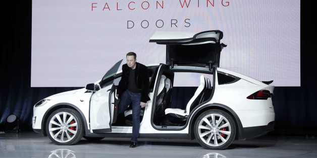Elon Musk, CEO of Tesla Motors Inc., introduces the Model X car at the company's headquarters Tuesday, Sept. 29, 2015, in Fremont, Calif. Musk said the Model X sets a new bar for automotive engineering, with unique features like rear falcon-wing doors, which open upward, and a driver's door that opens on approach and closes itself when the driver is inside. (AP Photo/Marcio Jose Sanchez)
