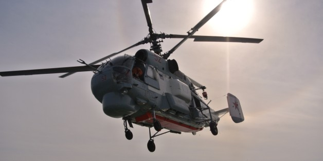 A Russian navy helicopter takes off from the deck of the Russian destroyer Vice Admiral Kulakov on patrol in eastern Mediterranean on Thursday, Jan. 21, 2016. Russian warships equipped with an array of long-range missiles cruise off Syria's coast to back the air campaign in Syria and project Moscow's naval power in the Mediterranean. (AP Photo/Vladimir Isachenkov)