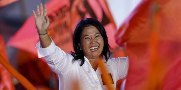 Peru's presidential candidate Keiko Fujimori of 'Fuerza Popular' party waves to supporters during her closing campaign meeting in Lima, Peru, April 7, 2016. REUTERS/Mariana Bazo