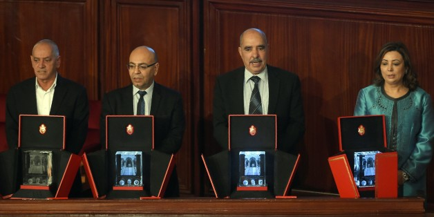 The 2015 Nobel Peace Prize laureates of the Tunisian National Dialogue Quartet (RtoL)  the President of the Tunisian employers union (UTICA) Wided Bouchamaoui, the President of the Tunisian Human Rights League (LTDH) Abdessatar Ben Moussa, the President of the National Order of Tunisian Lawyers Fadhel Mahfouz, the Secretary General of the Tunisian General Labour Union Houcine Abbassi pose on February 16, 2016 in Tunis during a session at the Assembly of People's Representatives (ARP). / AFP / FE