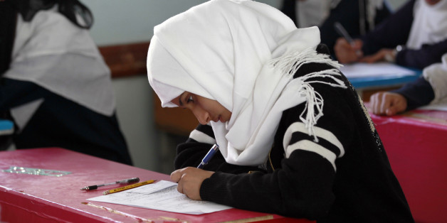 A Yemeni female student sits for the mid-year school exams at a secondary school on February 9, 2016 in the capital Sanaa.    / AFP / MOHAMMED HUWAIS        (Photo credit should read MOHAMMED HUWAIS/AFP/Getty Images)