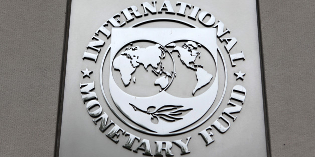 The International Monetary Fund (IMF) logo is seen at the IMF headquarters building during the 2013 Spring Meeting of the International Monetary Fund and World Bank in Washington, April 18, 2013. REUTERS/Yuri Gripas (UNITED STATES - Tags: POLITICS BUSINESS)
