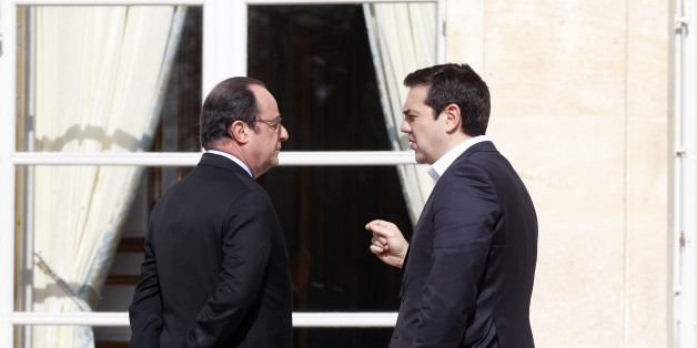PARIS, FRANCE - MARCH 12:  French President Francois Hollande speaks with Greek Prime minister, Alexis Tsipras after a family photo at the Elysee Presidential Palace on March 12, 2016 in Paris, France. Francois Hollande met the European social democratic leaders on the future of the European Union.  (Photo by Chesnot/Getty Images)