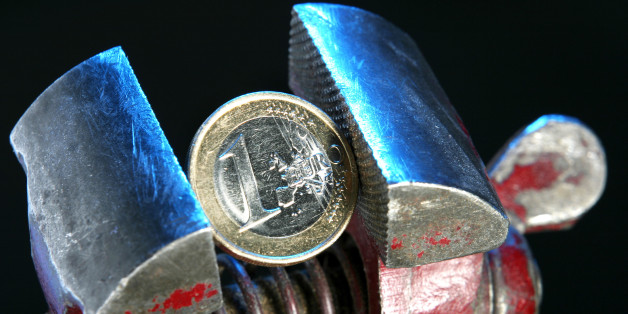 Euro coin in vice