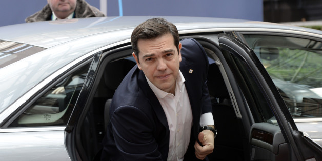 Greek Prime Minister Alexis Tsipras arrives for an European Union Summit at the EU headquaters in Brussels, on March 18, 2016.Leaders from six EU nations led by Britain were holding talks Friday on how to tackle migration from Libya at a Brussels summit focused on dealing with an unprecedented influx of people fleeing war in Syria. Around 330,000 have come to Italy via Libya since the start of 2014 while more than a million have reached Europe, landing in Greece via Turkey. / AFP / THIERRY CHARL