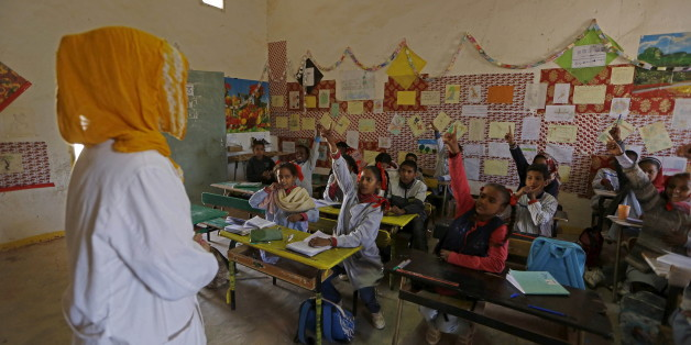 An indigenous Sahrawi teacher attends teaches at a school in Boudjdour desert refugee camp in Tindouf, southern Algeria March 3, 2016. In refugee camps near the town of Tindouf in arid southern Algeria, conditions are hard for indigenous Sahrawi residents. Residents use car batteries for electricity at night and depend on humanitarian aid to get by. The five camps near Tindouf are home to an estimated 165,000 Sahrawi refugees from the disputed region of Western Sahara, according to the United Na